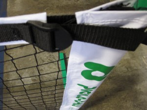 3.0 Tournament Net uses a strap woven through a buckle to tighten the net