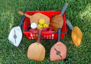 Basket of pickleball paddles