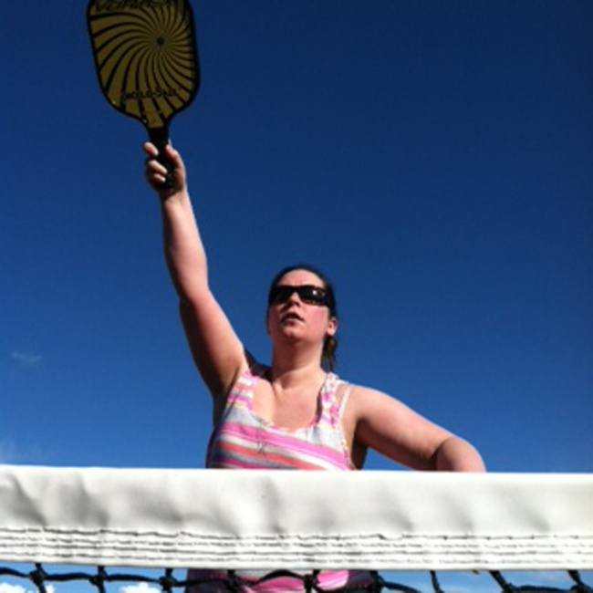 Rachel reaching for a pickleball