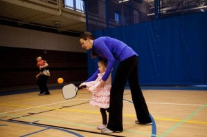 health benefits child and adult playing pickleball