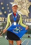 Carolyn Ebbinghaus on the medals platform at National Pickleball Tournament