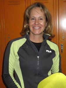 Pickleball Pro Carolyn Ebbinhaus of Traverse City, Michigan with a yellow pickleball paddle in her hand