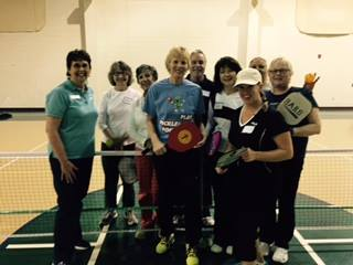 Judy Bowman, center, and pickleball aficionados at the YMCA in VA