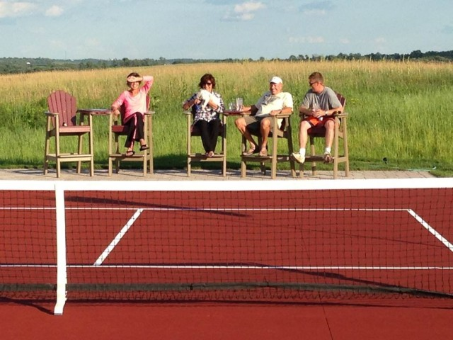 Watching a game of pickleball on completed court