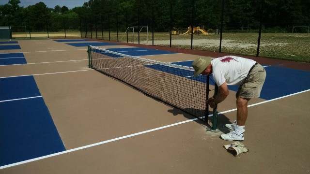 Installing pickleball posts and nets