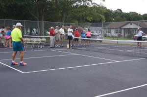 Mayor McCullough serving the first ball — at Delilah Oaks Pickleball Courts
