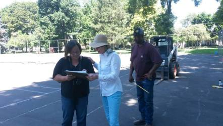 Nancy Kress consults with Eagle Fence owners RaeJean and Tom