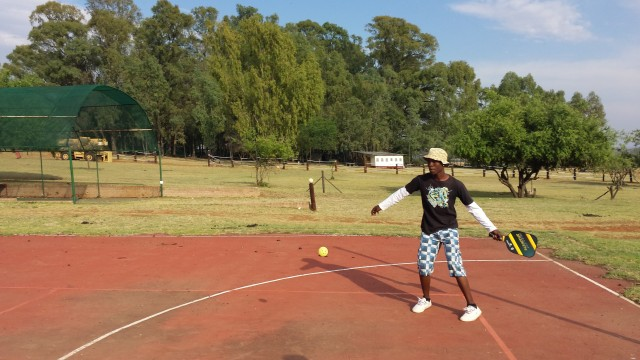Playing pickleball at Camp Sizanini