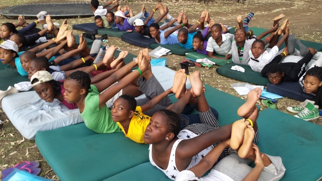Yoga class at Camp Sizanini