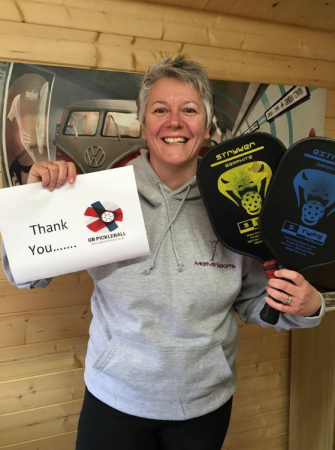 Clare Maclean-Bell with the first paddles donated to her organization, GB Pickleball