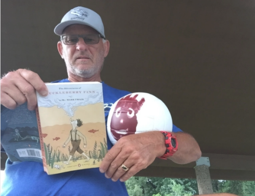 Dave with Wilson (created by his Arizona pickleball family) and a copy of Huck Finn