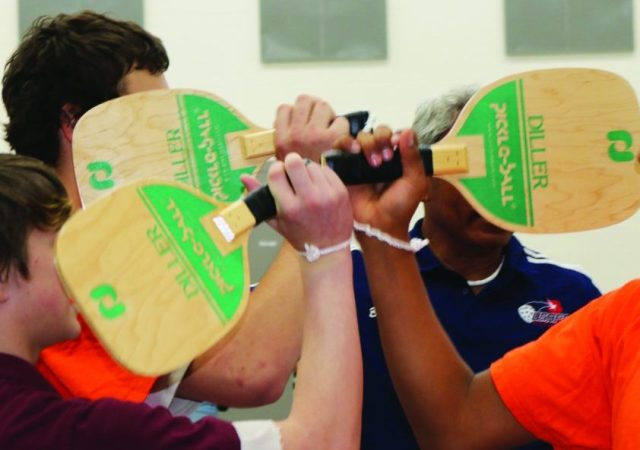 "The youth of the YCDC tapping paddles in the ""good game"" gesture"