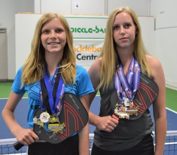 McKenna and Kendall Hastings at Pickleball Station with their winning medals