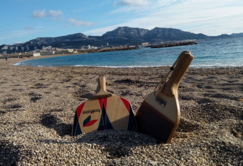Paddles in sand