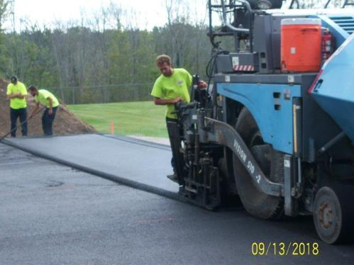 Putting second smooth coat of asphalt down